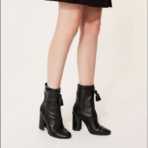 Tory Burch black Huxley leather tassel ankle boots